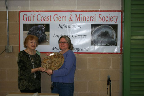Raffle Winner Cindy McCown being presented her Raffle Prize by Rusty Bluntzer.